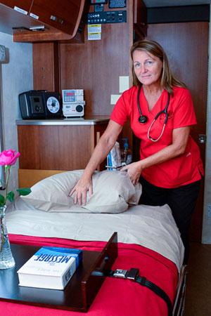 Nurse and hospital bed.